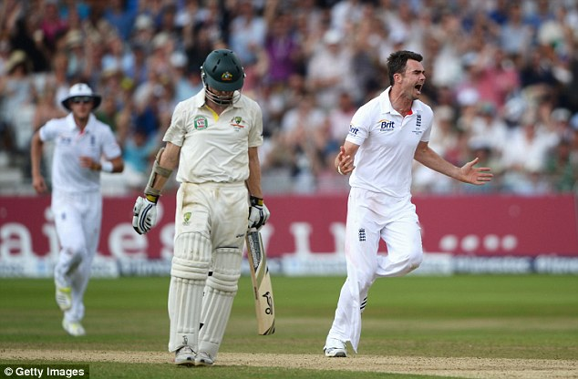 Contrast: Anderson celebrates his crucial wicket of Rogers as the Aussie opener trudges off