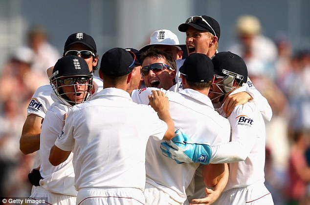 Jubilant: England celebrate Swann's wicket of Smith, the second in two deliveries for the home side