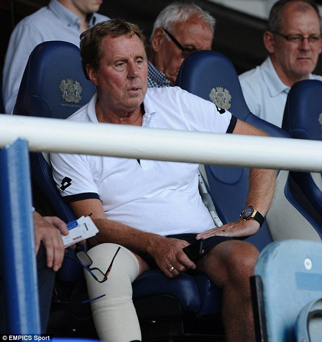 Cast: The QPR manager sits in the stands with a plaster cast on his leg during the 0-0 friendly with Exeter City on Friday night