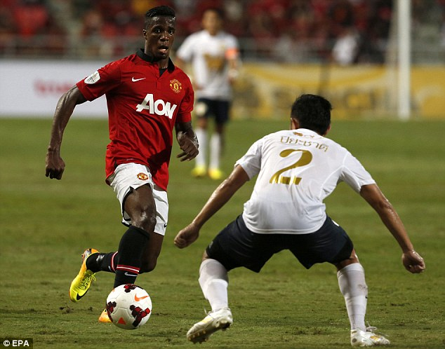 Impressed: Wilfried Zaha (left) produced a pleasing performance in United's defeat by the the Singha All Star team