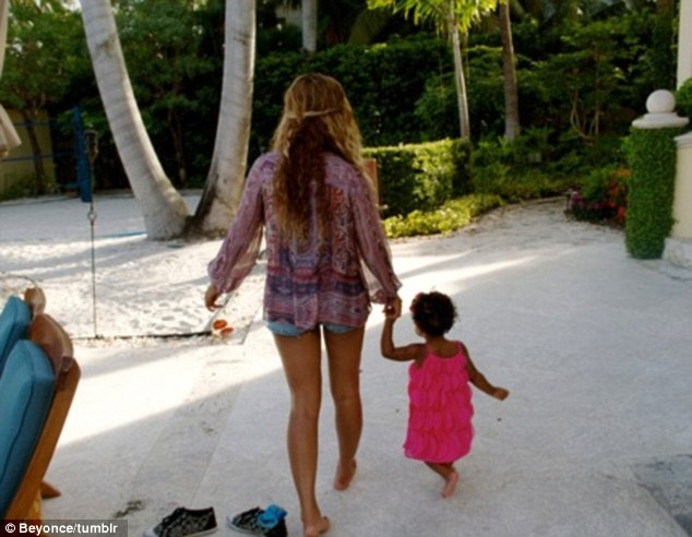 Barefoot beauties: The wife of Jay-Z treated her daughter to a beach holiday