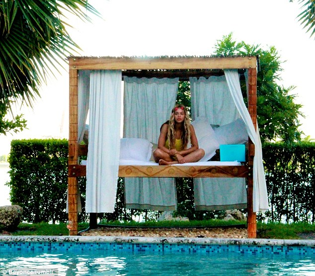A queen on her throne: The Single Ladies singer looked at peace on a personal cabana