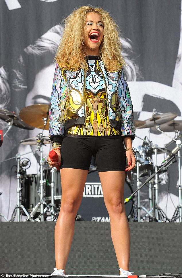 Quick change: Rita Ora rocked the main stage at Wireless earlier in the day, wearing a patterned T-shirt and matching jacket, paired with black cycling shorts