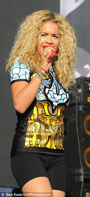 Typically quirky: The pop star stuck to her unique sense of style as she entertained the crowds at the London festival