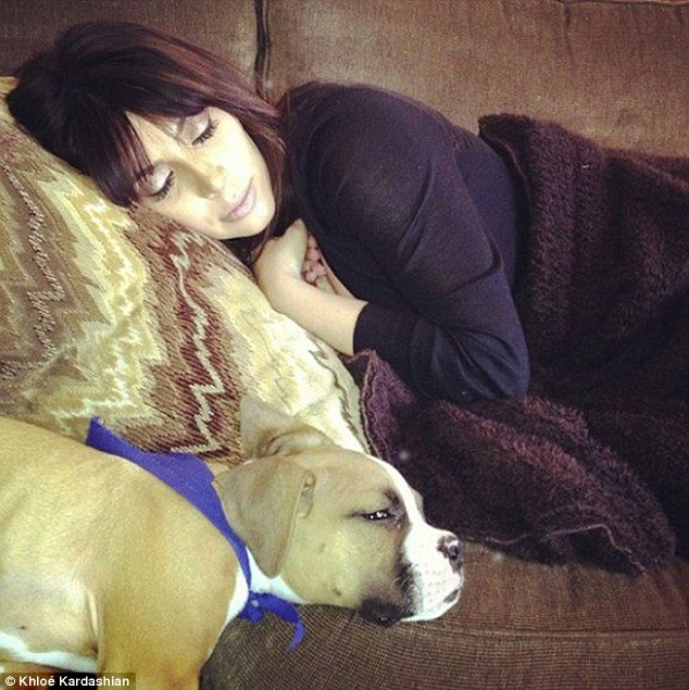 Dog tired: Khloé Kardashian Odom published this too-cute pic of her sister taking a nap with Khloé's puppy, Bernard Hopkins, on Facebook on June 28 - the first time she's been pictured since giving birth last month