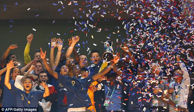 Winners: France lift the trophy for the Under 20's World Cup after beating Uruguay on penalties