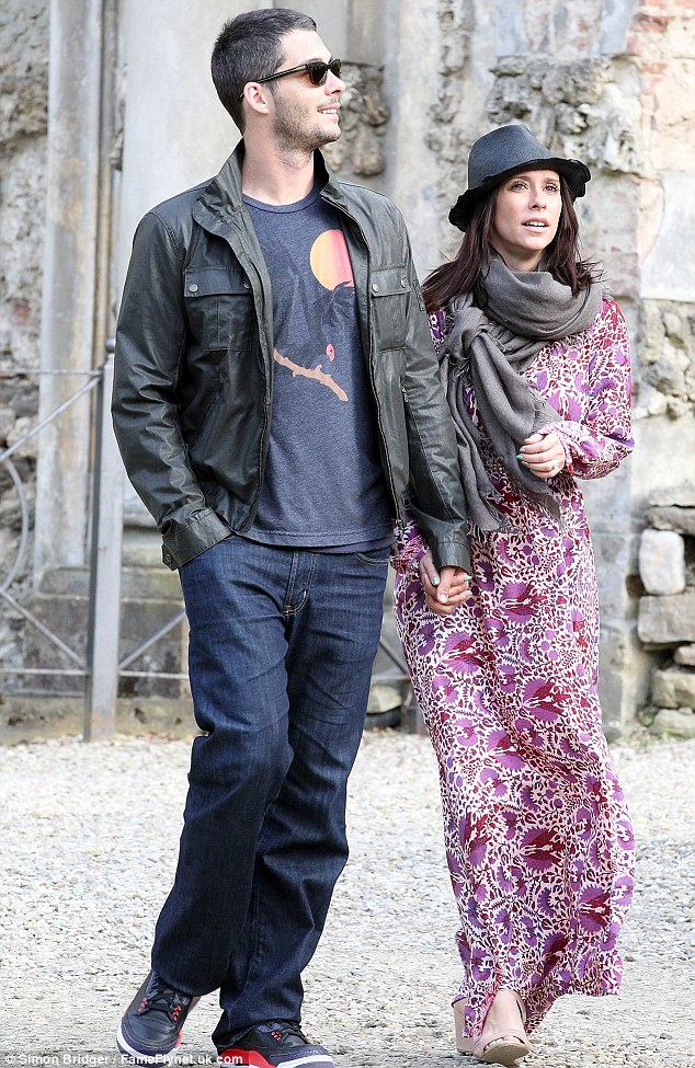 Happy couple: Jennifer and her fiance Brian Hallisay go for a stroll in Florence, Italy back in May.