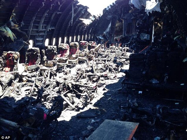 Beyond recognition: The charred remains of Asiana Airlines Flight 214 after crash landing in San Francisco