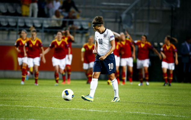 Dejection: Fara Williams looks downbeat as Spanish players celebrate their second goal