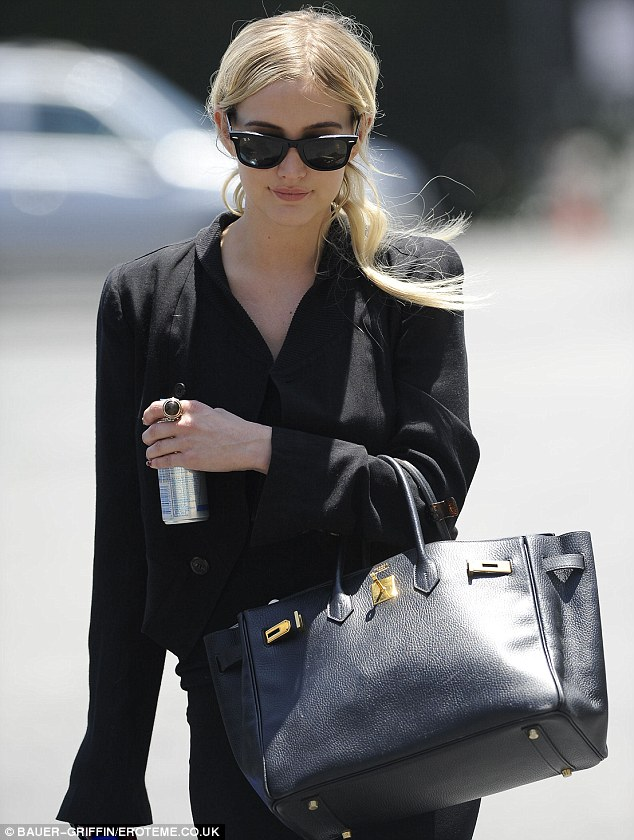 Instant energy: The actress and singer clutched a can of red bull and a flask of water in preparation for her rehearsal