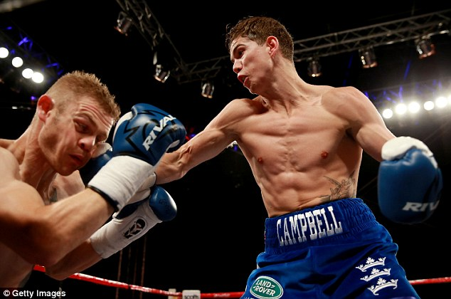 Dominant: Campbell connects with Andy Harris on the way to the first-round stoppage victory