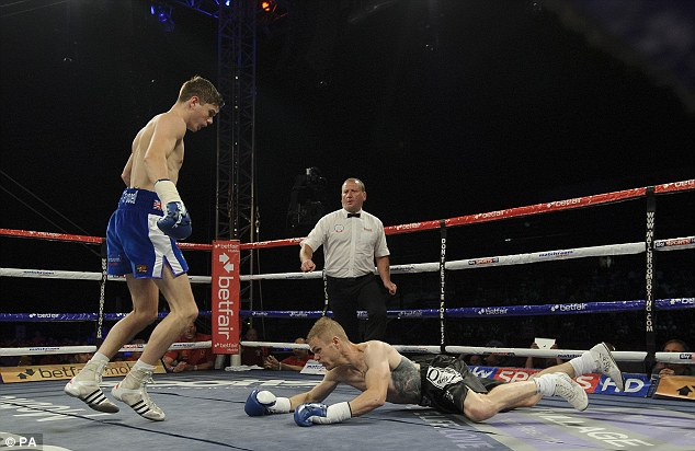 Easy prey: Harris falls to the canvas as Campbell knocks him down on the way to a first professional win