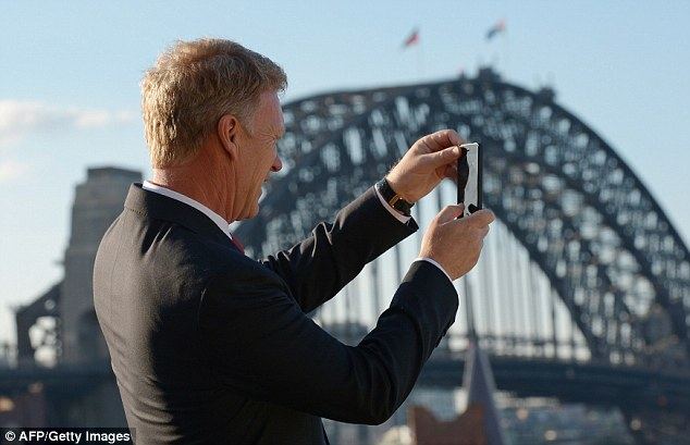 Snap that: Moyes uses his phone to take a picture of one of Australia's great sights