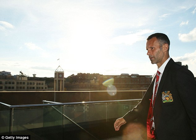 Here we go: Giggs arrives for the Manchester United press conference at the Museum of Contemporary Art