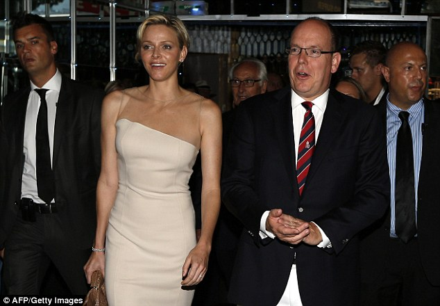 Happily married: Princess Charlene pictured with her husband Prince Albert II of Monaco on Saturday