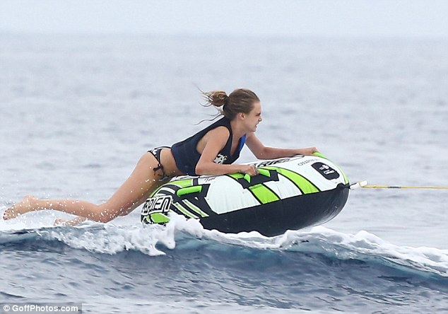 The model of the moment clung to the ring for dear life as she was pulled along by a speedboat