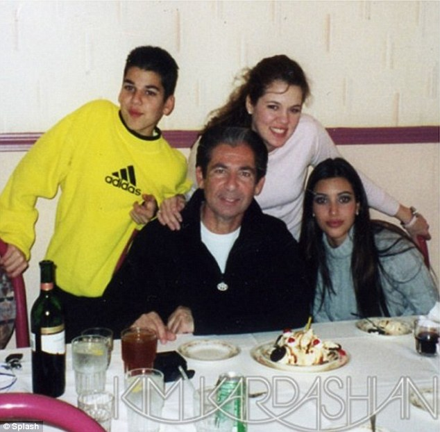 Fun times: Kim posted this  image of her late father with Rob, Khloe and herself on her website