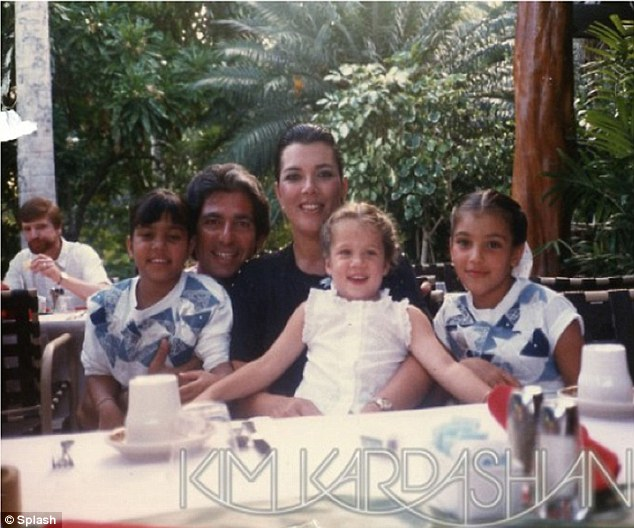 Happier times: Kim posted this image of her late father Robert with Kris, Kourtney and herself via her official website on Father's Day