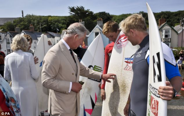 Choppy waters: The Prince of Wales and Duchess of Cornwall also met local surfers in Bude
