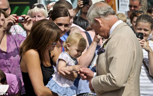 Income: Last year the Duchy of Cornwall made £19million in profits for Prince Charles, who met 16-month old Jasmine Marsh and her mum Jessica Marsh, 34, during his annual visit to Cornwall