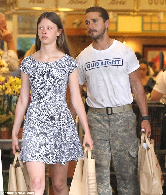 Routine: Shia dressed in his battle fatigues as he shopped with his girlfriend Mia Goth on Wednesday
