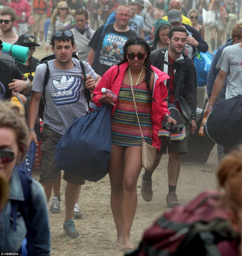 Revellers looked glum as they left the Scottish campsite - but at least they have some sunshine to head back to