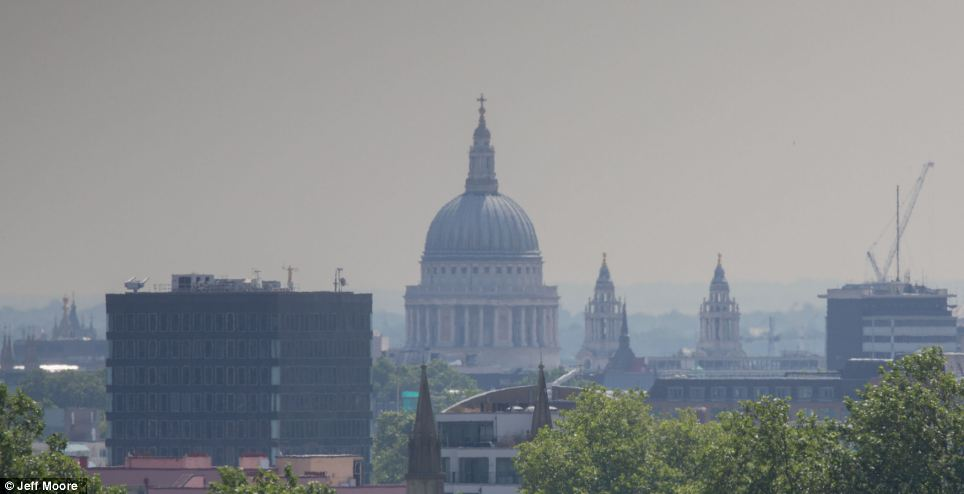 London, including St Paul's Cathedral, shimmered in the hazy light today, as temperatures reached their late twenties across the country
