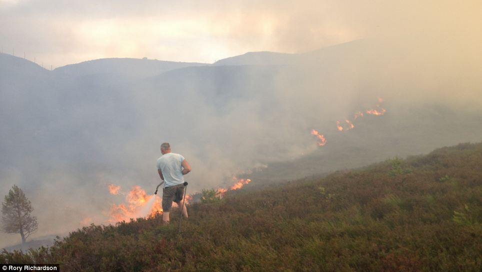 Dangerously hot: Fire crews dealt with a large grass fire halfway between Dalwhinnie and Laggan in Scotland on Sunday evening