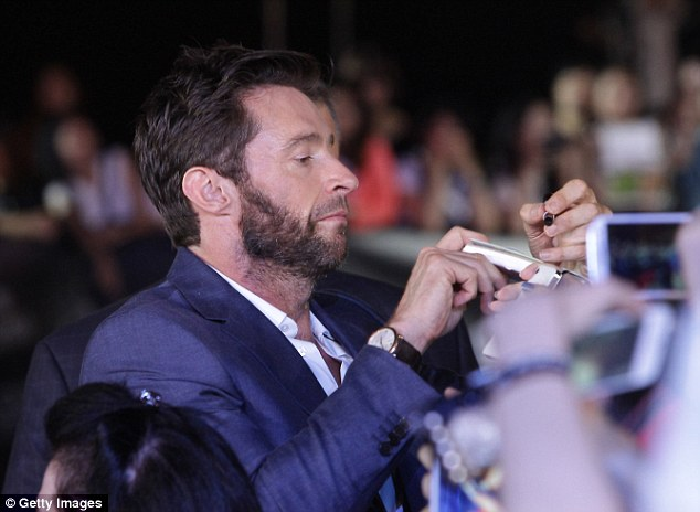 The actor signs autographs for adoring fans at the Seoul premiere of The Wolverine
