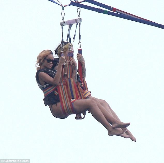 High flying: Rihanna was seen getting her kicks parasailing in Monte Carlo last week