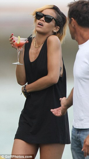 Drink up: Rihanna was seen enjoying a couple of fresh and fruity looking cocktails