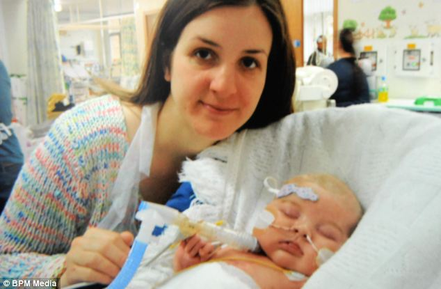 Oscar was so ill his mother, Lois, (pictured) was told not to hold him because even the slightest touch could trigger a fatal heart attack