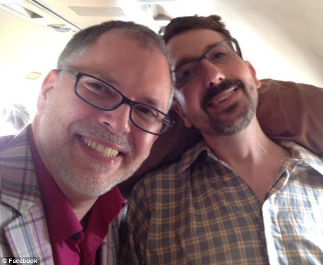Just married: John Arthur (right), who suffers from ALS, grins alongside his partner of 20 years, Jim Obergefell, just moments after they married aboard a plane in Maryland earlier this month