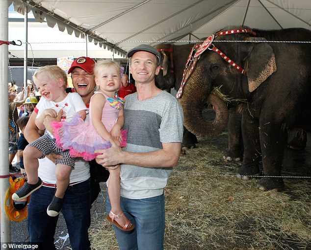 Clowning around! Neil and David laughed with their adorable twins as they posed with the elephants at the circus on Sunday