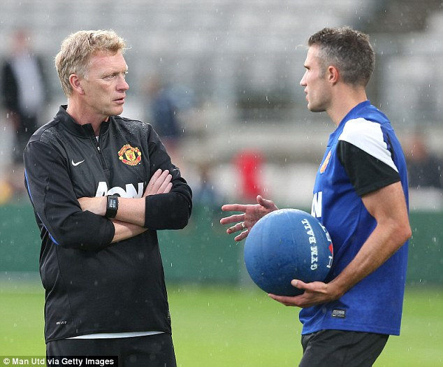 So, how many goals will you get? David Moyes chats with striker Robin van Persie in training after the Dutchman linked up with the United squad in Sydney