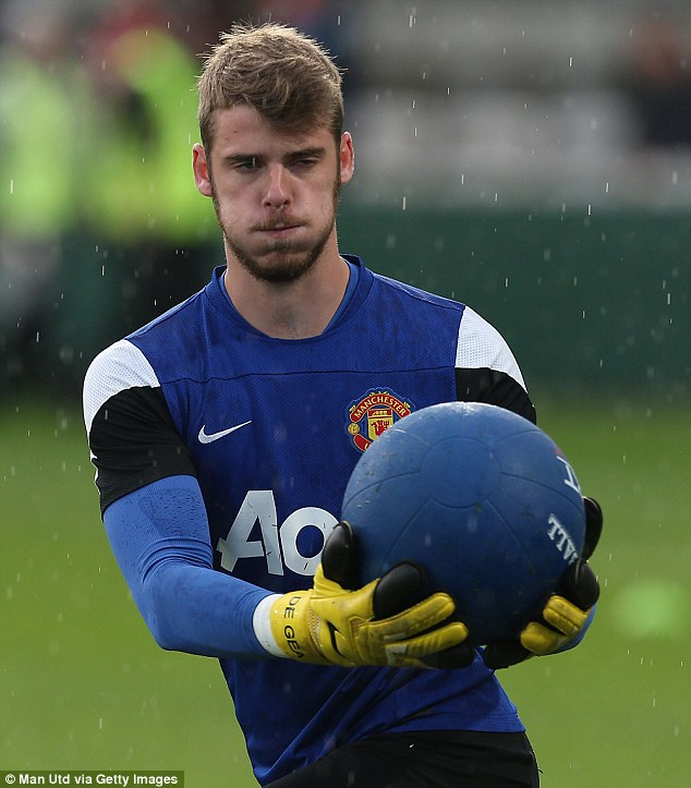 Twist and turn: David de Gea gets to grips with the medicine ball as he limbers up for the season ahead
