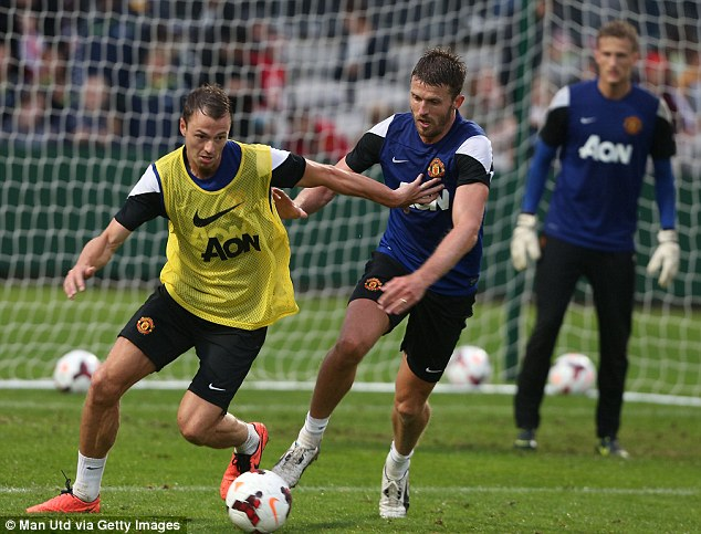 Hands off: Jonny Evans tries to escape Michael Carrick during the practice match