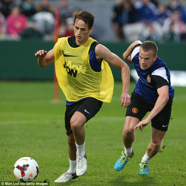 Young star: Adnan Januzaj, one of United's best performers in Thailand, gets away from Tom Cleverley