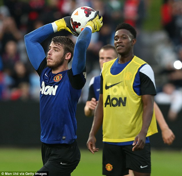 Safe hands: The Spanish goalkeeper, who was one of United's best performers last season, throws the ball out