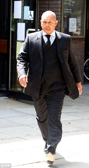 In the dock: Ray Wilkins leaves Staines Magistrates court in Surrey