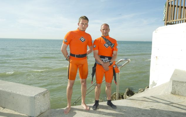 Lifeguards Huart Alexandre, 22, left and Giolet Rudolph, 35, right, went to Susan's aid and performed first aid and CPR