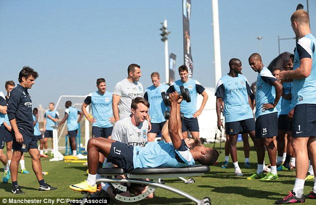Bench-warmer: Scott Sinclair works out as his City team-mates look on