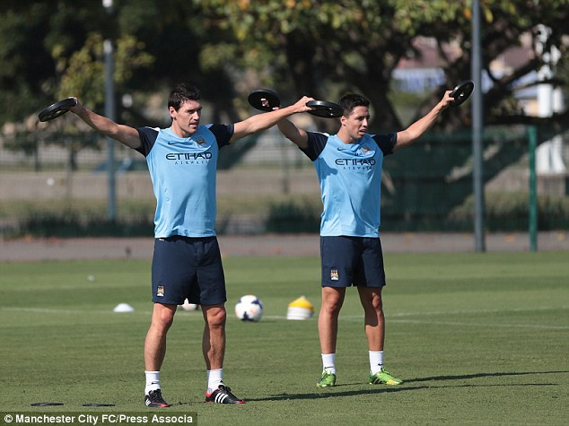 Midfield maestros: Gareth Barry (left) and Samir Nasri test out their strength