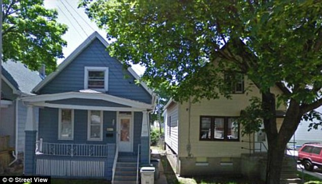 Neighbors: Spooner was arrested after waiting for police at the crime scene. He lives in the cream house, right, while Darius Simmons lived in the blue house, left