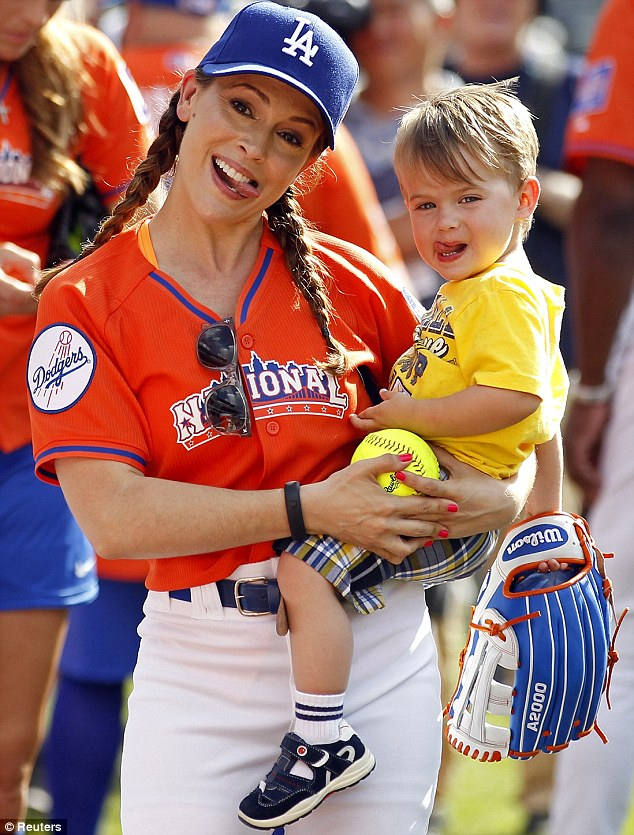 Copy kid: Alyssa took her son, Milo, to the Legends and Celebrities All-Star softball game at Citi Field in New York Sunday