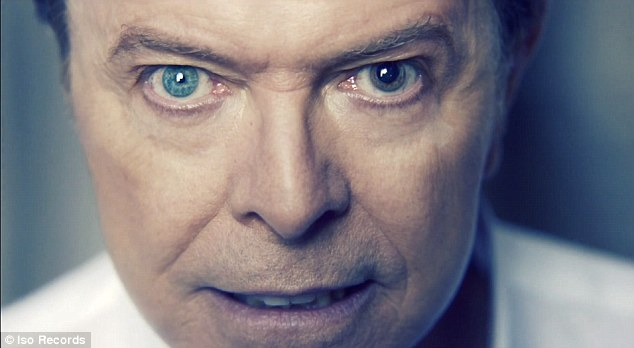 Unusual: The back to basics video features numerous close-ups of Bowie's famous mismatched eyes