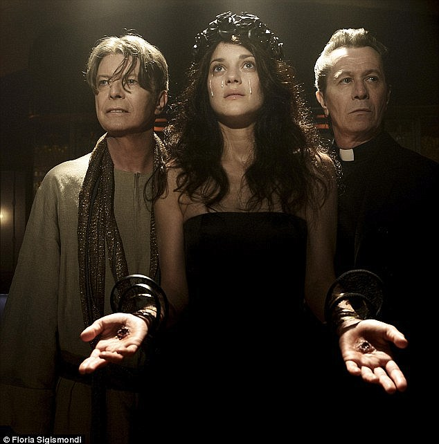 Shocking: Heavily criticised by The Catholic League for its religious iconography, the video saw Bowie depicted as Christ, while Oscar-winning actress Marion Cotillard took on the role of a prostitute suffering from stigmata