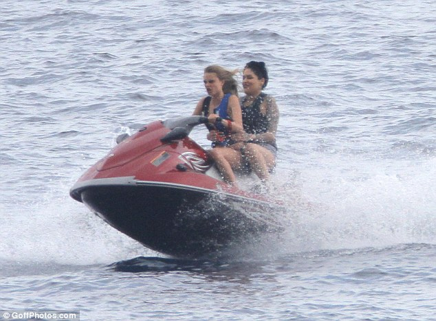 Zipping through the waves! The Burberry beauty later hopped on board a jet-ski with a friend as she continued her day of aquatic activities