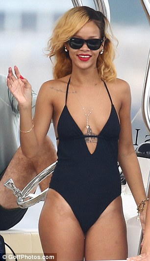Taking the plunge: The Diamonds singer looked incredible in a low-cut black swimsuit