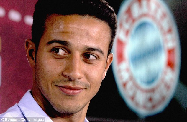 All smiles: Thiago has signed a four-year deal with Bayern